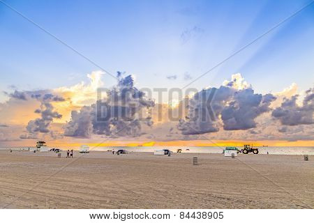 People In Late Afternoon Walk Along South Beach And Enjoy The Sunset