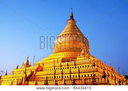 Shwezigon Pagoda At Sunrise In Bagan Archaeological Zone, Myanmar