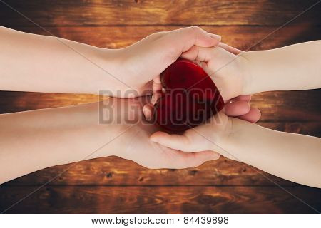 Mother's Hands Holding Baby Hands With Heart