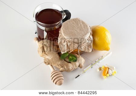 Thermometer,   Pills And Vitamins Vs Jar Of Honey , Tea, Ginger, Lemon