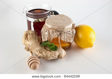 Honey In Jar , Cup Of Tea, Mint,   Lemon And Ginger  On A White Background