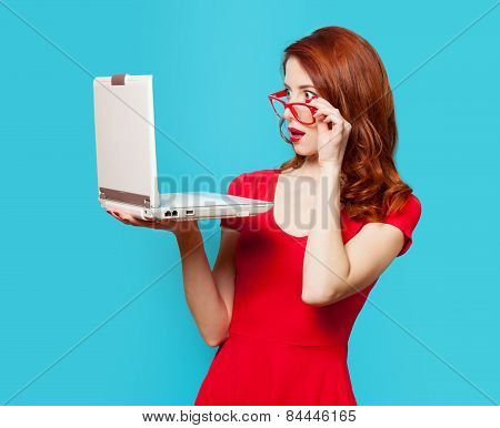 Surprised Redhead Girl With Laptop
