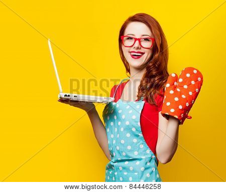 Young Housewife With Computer And Oven Gloves