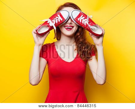 Smiling Redhead Girl With Gumshoes