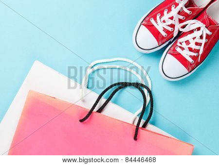 Red Gumshoes With Shpping Bags