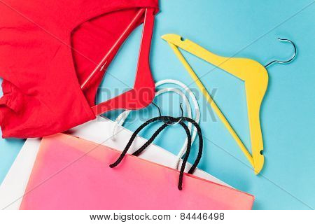 Shopping Bags And Hangers With Red Dress
