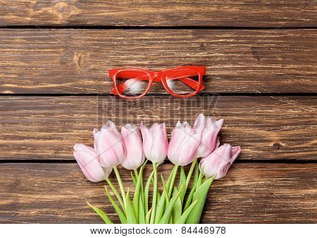 Red Glasses And Bouquet Of Tulips