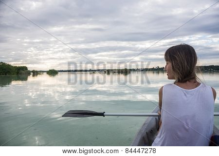 Young Girl Kayaking At Bacalar, Near Cancun, Traveling Mexico. Beautiful Caribbean.