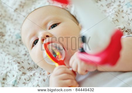 Sweet Baby Biting A Toy