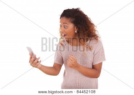 Angry African American Woman Screaming To Her Mobile Phone