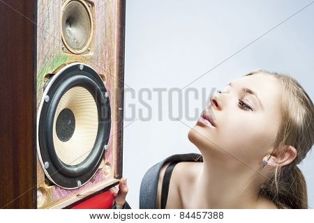 Portrait Of Young Caucasian Woman Listening To Speaker