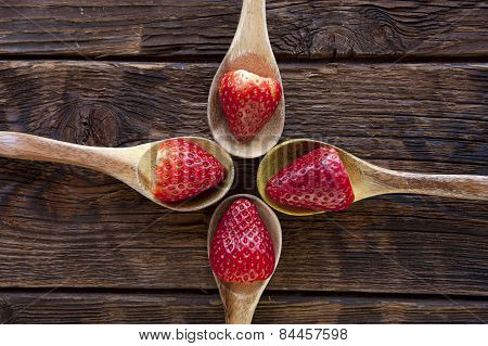 Ripe Strawberries On Wooden Spoons.