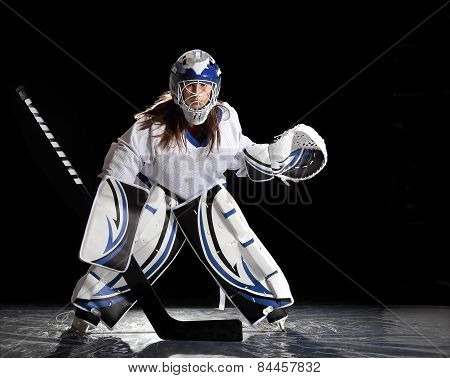 Young female ice hockey goalie
