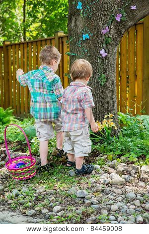 Two Boys Looking For Easter Eggs
