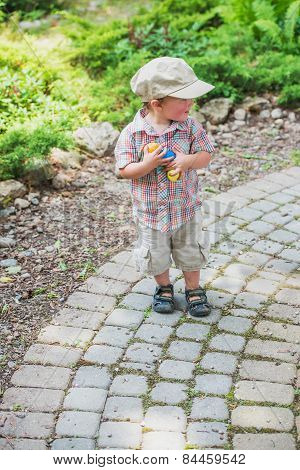 Little Boy Smiling Holding Colorful Easter Eggs