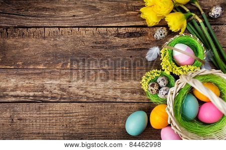Baskets With Colored Eggs And Flowers