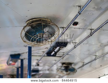 Old Ceiling Fan  Blurred Slightly As Blades Turn On The Bus