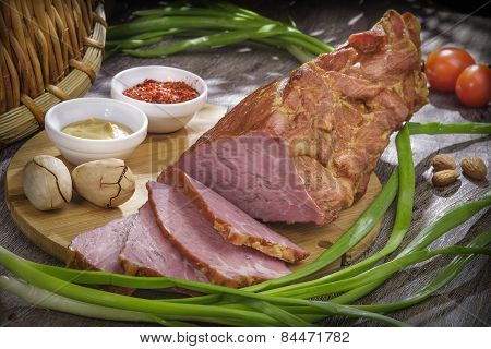 Ham meat is delicious mouth-watering slices of gourmet food, green onions, spices,