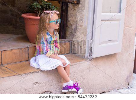 Adorable little girl outdoors in European city