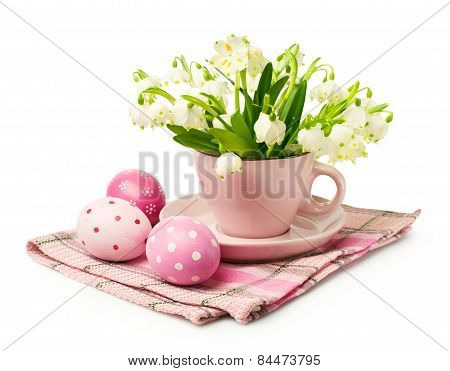Bouquet Of Snowdrops In A Pink Cup And Easter Eggs