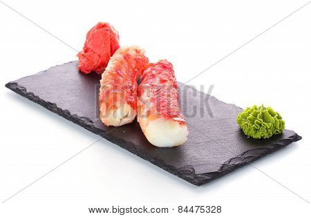 Crab Sticks On Stone Plate Isolated On White Background