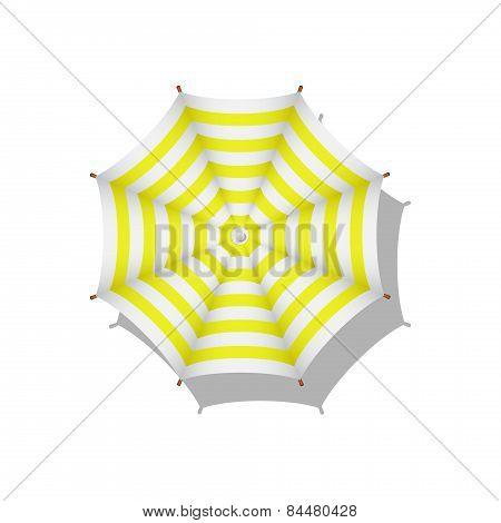 Yellow and white striped beach umbrella