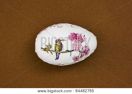 Beautiful Painted Easter Egg With Bird On The Brown Background