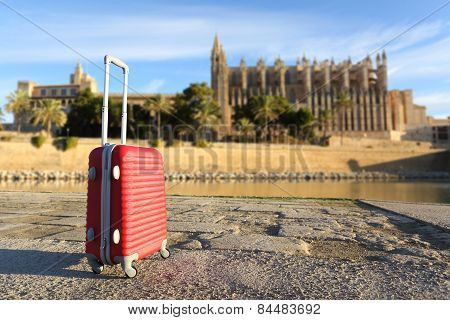 Tourist Concept With A Suit Case In A Touristic Place