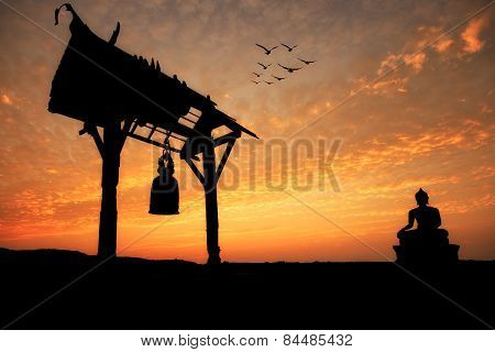 Silhouette Of Buddha Statue And Bell