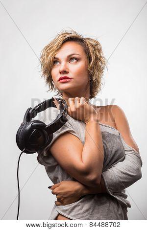 Cute blonde girl posing in the studio.