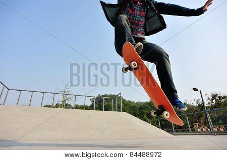 young skateboarder legs skateboarding at skatepark
