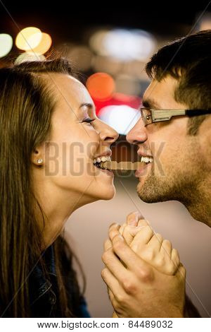Couple eating chocolate on date