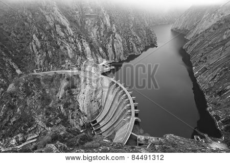 Landscape With River, Cliffs And A Dam In Spain
