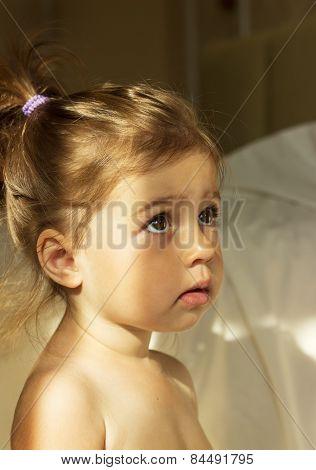 Little cute girl is afraid