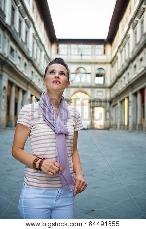 Young Woman Near Uffizi Gallery Looking Into Distance In Florenc