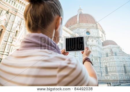 Young Woman Taking Photo With Tablet Pc Of Cattedrale Di Santa Maria Del Fiore In Florence, Italy. R