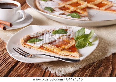 Piece Of Italian Tart With Apricot Jam And Coffee