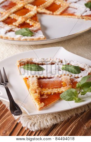 Slice Of Italian Tart With Apricot Close-up. Vertical