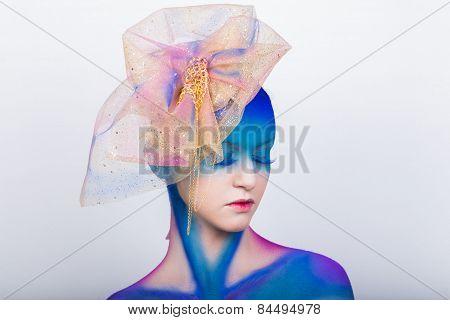 Creative makeup. Airbrush. Blue, indigo, violet makeup.