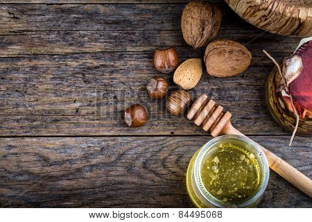 Honey Dipper And Nuts In Honey And Nuts Of Various Kinds,