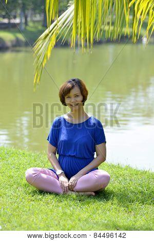 Pregnant Woman Posing In Park