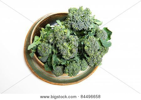 Plate With Raw Sicilian Broccoli On White Background