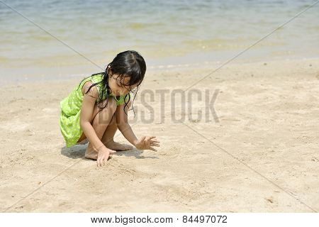 Asian Girl Playing On The Beach