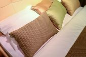 stock photo of pillowcase  - Luxury hotel room setting with bed and a pillows - JPG
