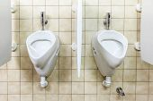 picture of urinate  - urinals in an old building for men only - JPG