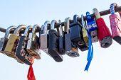 stock photo of lock  - Padlocks are a symbol of love locked on a bridge - JPG