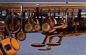 picture of saxophones  - closeup of old black saxophone focus on foreground - JPG