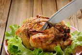 pic of bondage  - Bondage shibari roasted chicken on wooden background cutting cord closeup horizontal - JPG