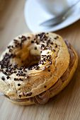 pic of brest  - Paris-Brest cake with chocolate mousse on a wooden table ** Note: Soft Focus at 100%, best at smaller sizes - JPG