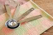 image of tablespoon  - measuring spoons kitchen utensil on cloth and table - JPG